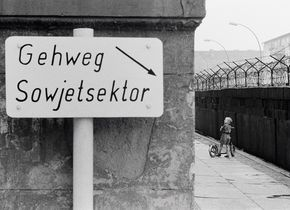 Thomas Hoepker, Child with Scooter at the Berlin Wall. This pedestrian way belongs to the Soviet Sector of Berlin. Berlin, Germany, 1963. © Thomas Hoepker / Magnum Photos.