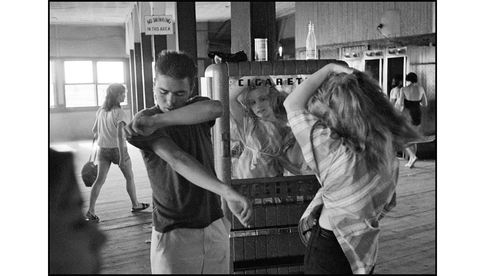 Bruce Davidson - USA. New York City. 1959. Brooklyn Gang. Coney Island. Cathey fixing her hair in a cigarette machine mirror.