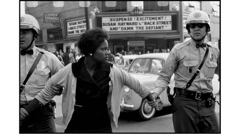 "Bruce Davidson - USA. Alabama. Birmingham. 1963. Arrest of a demonstrator. ""Damn the Defiant!"""